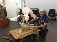 Miles Tucker arriving at the foundry with 'The Eagle Has Landed' work.