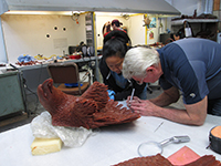Miles Tucker adding finishing touches to the wax rendition of 'The Eagle Has Landed' bronze sculpture prior to casting.