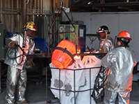 Foundry persons pouring the molten bronze for casting 'The Eagle Has Landed' bronze sculpture by Miles Tucker.